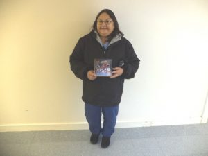 Laura Sutherland holding her digital camera prize