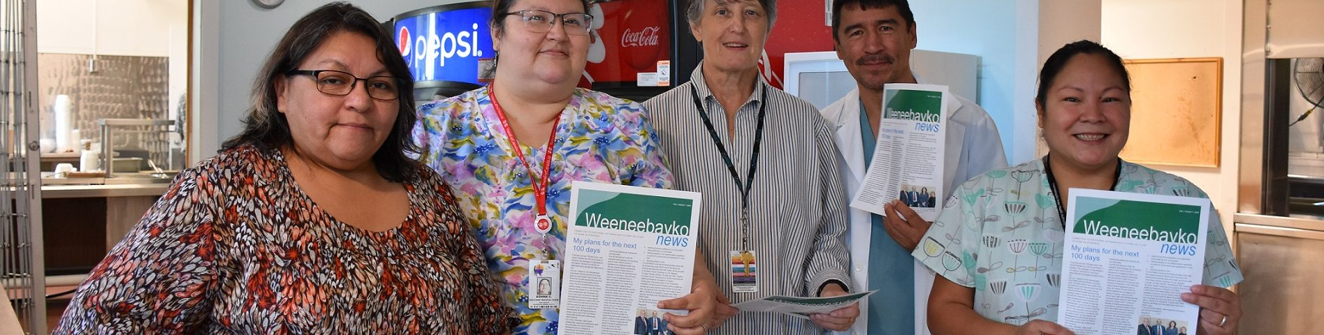 WAHA Staff hold our newly relaunched community newsletter Weeneebayko News